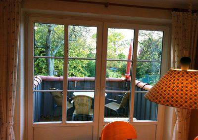 Balkon mit toller Fernsicht über Garten und Insel